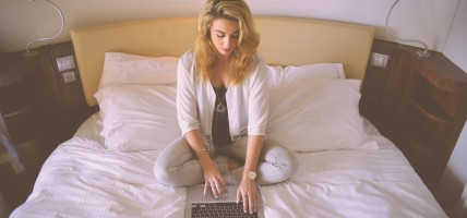 person-woman-hotel-laptop
